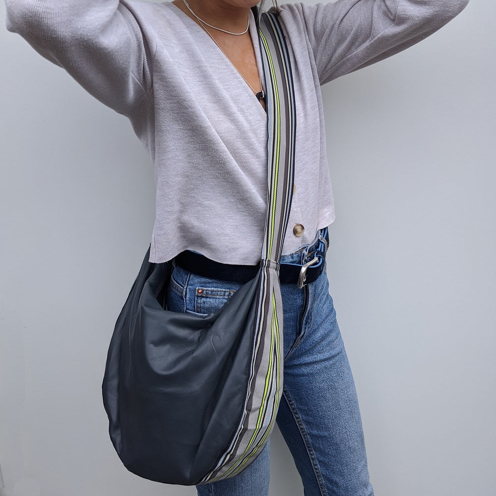 Band shoulder bag in soft dark grey leather on model