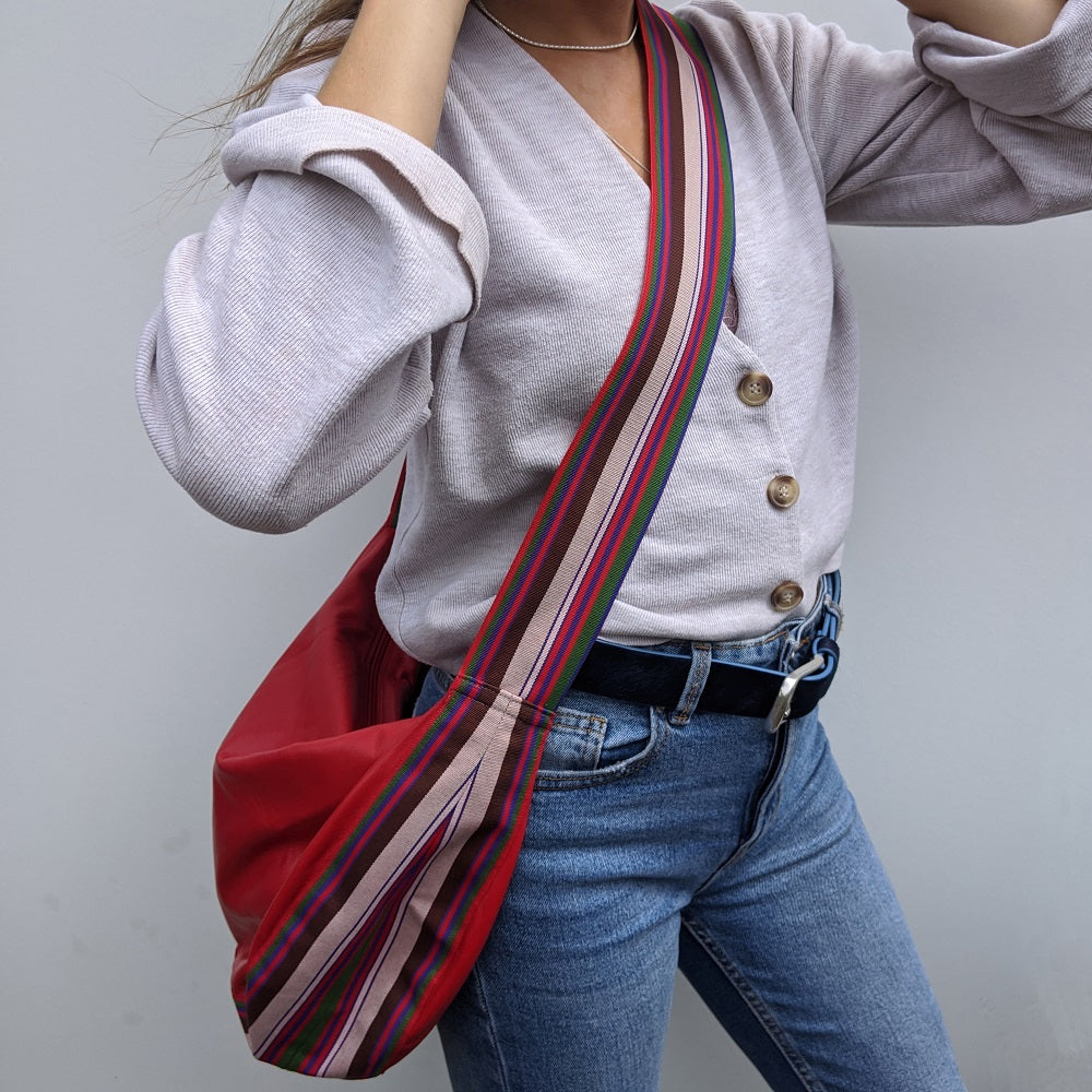 Band shoulder bag in soft red leather on model