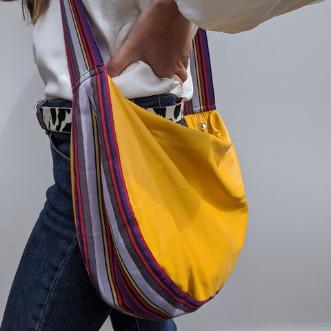 Image of Band shoulder bag in soft yellow leather on model