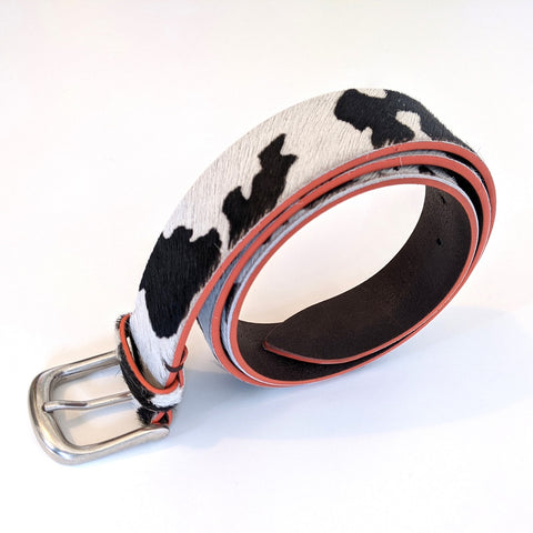 Image of  Delila Belt in Cow Print & Orange Edge