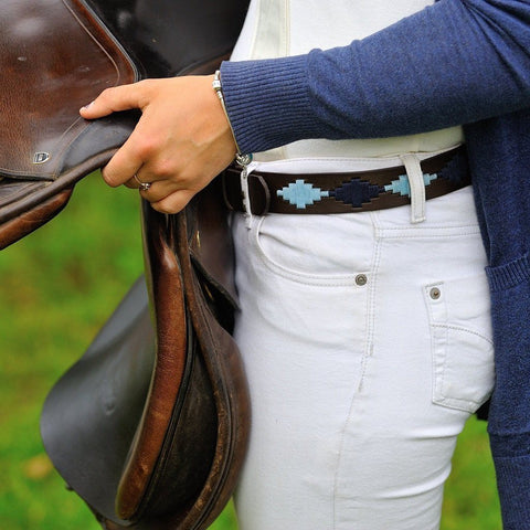 Argentinian embroidered bridle leather Polo belt in brown leather with navy & pale blue on a model