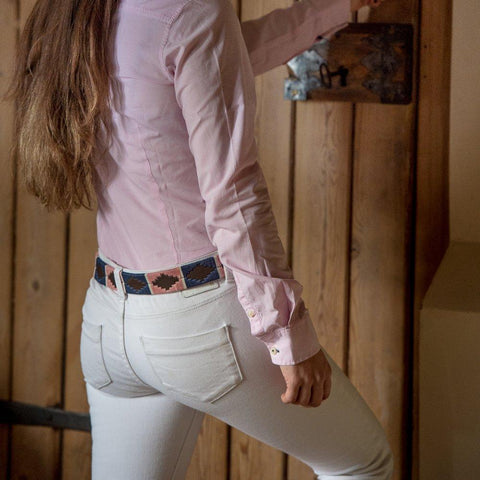 Argentinian embroidered bridle leather Polo belt in brown leather with pink, navy & white stripe on a model