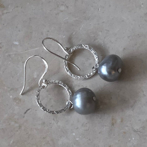 Sterling silver drop pearl earrings on a hook with a hammered finish and grey coloured pearls