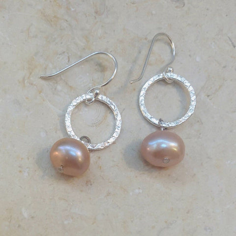 Sterling silver drop pearl earrings on a hook with a hammered finish and pink coloured pearls