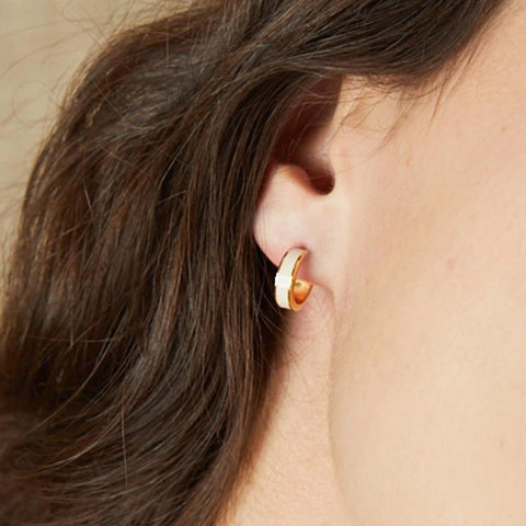 Image of  Small Enamel Hoop Earrings in Sand White on Model