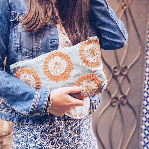 Image of Soft canvas travel pouch in blue Lamu pattern with model