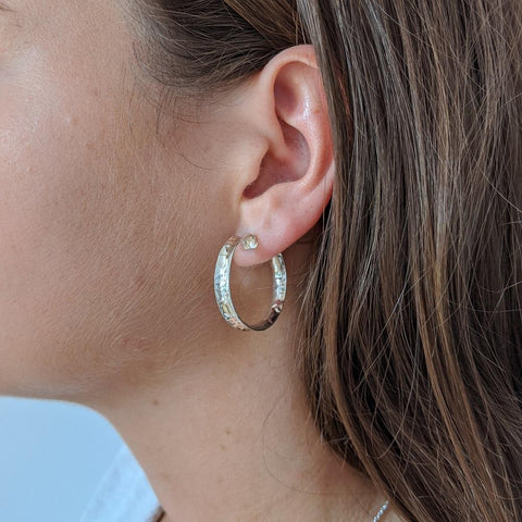 Large Hammered Silver Hoop Earrings on Model