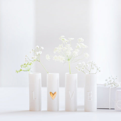 Image of Delicate porcelain love mini vases set of four by räder with flowers