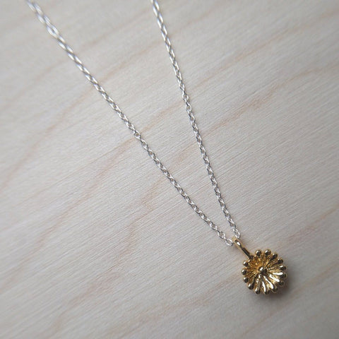 Detailed dainty flower necklace in gold plate on sterling silver on a 16 to 18 inch matching chain - wood background