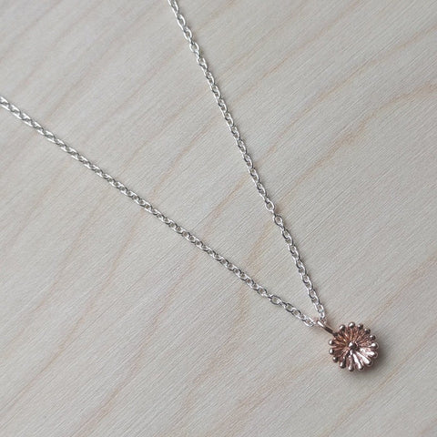 Detailed dainty flower necklace in rose gold plate on sterling silver on a 16 to 18 inch matching chain - wood background