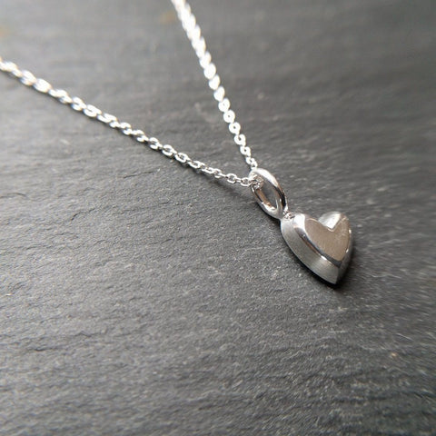 Devotion necklace with a 3D heart shaped charm in sterling silver on a 16 to 18 inch chain - on slate background
