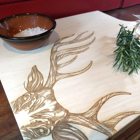 Image of Scottish sycamore cutting or serving board with engraved majestic stag decoration