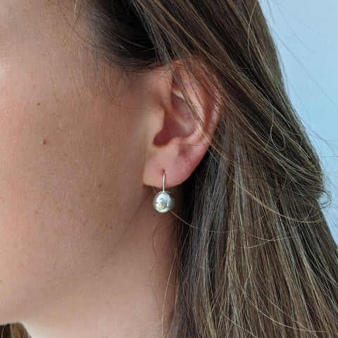 Image of  Sterling Silver Button Hook Earrings on Model
