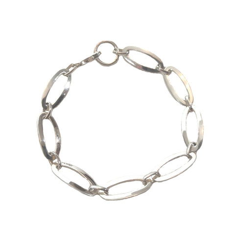 Oval linked bracelet in sterling silver with a lobster clasp on a white background