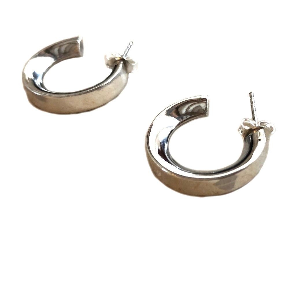 Small chunky sterling silver hoop earrings on a white background