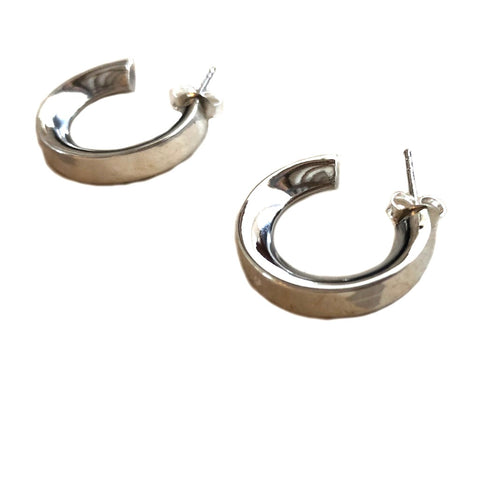 Image of Small chunky sterling silver hoop earrings on a white background