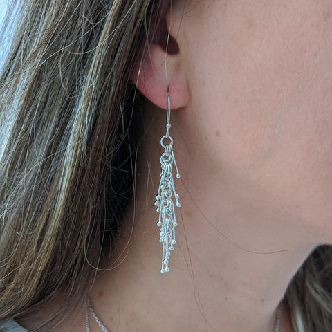 Spikey Silver Earrings on Model