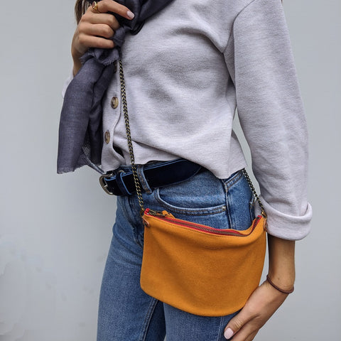 Image of Orange Suede Cross Body Pouch Bag - Model