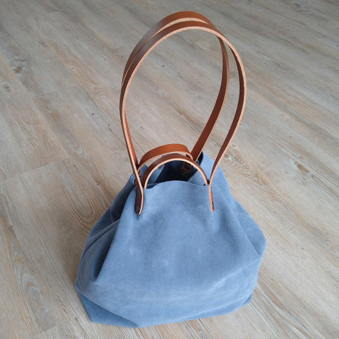 Image of Blue Suede Shoulder or Handheld Tote Bag on Floor