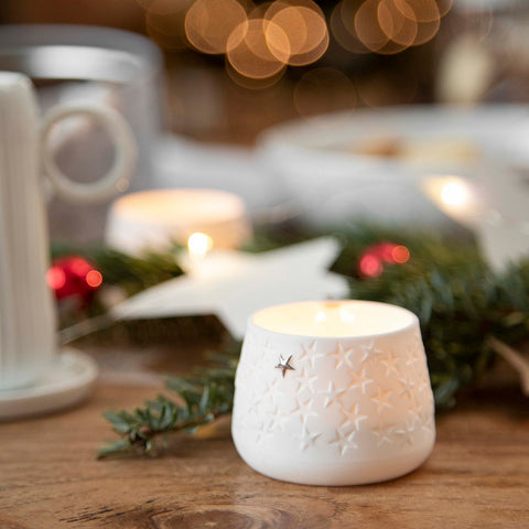 White porcelain tealight candle holder with stars pattern - table