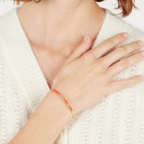 Image of  Thin Enamel Clasp Bracelet in Orange on Model
