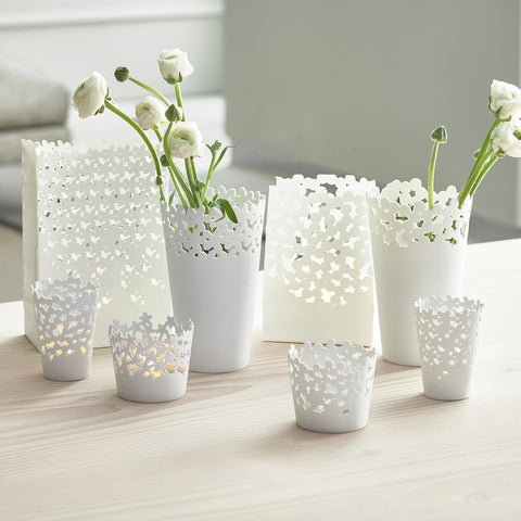 Delicate porcelain vases and table lights by räder in Blossom & Circles patterns