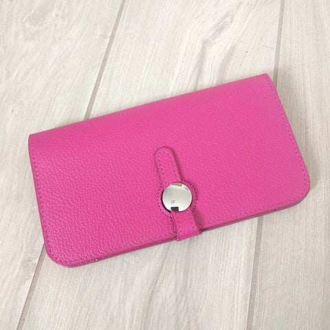 Genuine Italian leather travel wallet or purse with multi compartments in bright pink