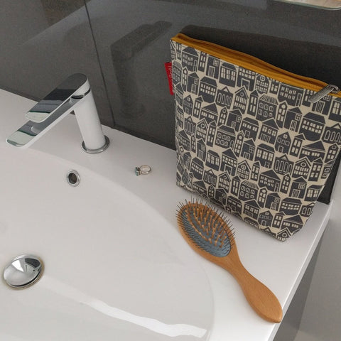 Large wash bag in bold About Town print on bathroom sink