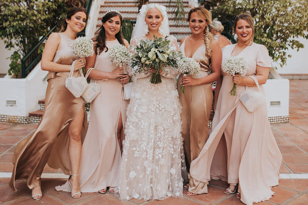 Mix-and-match champagne and blush bridesmaid dresses