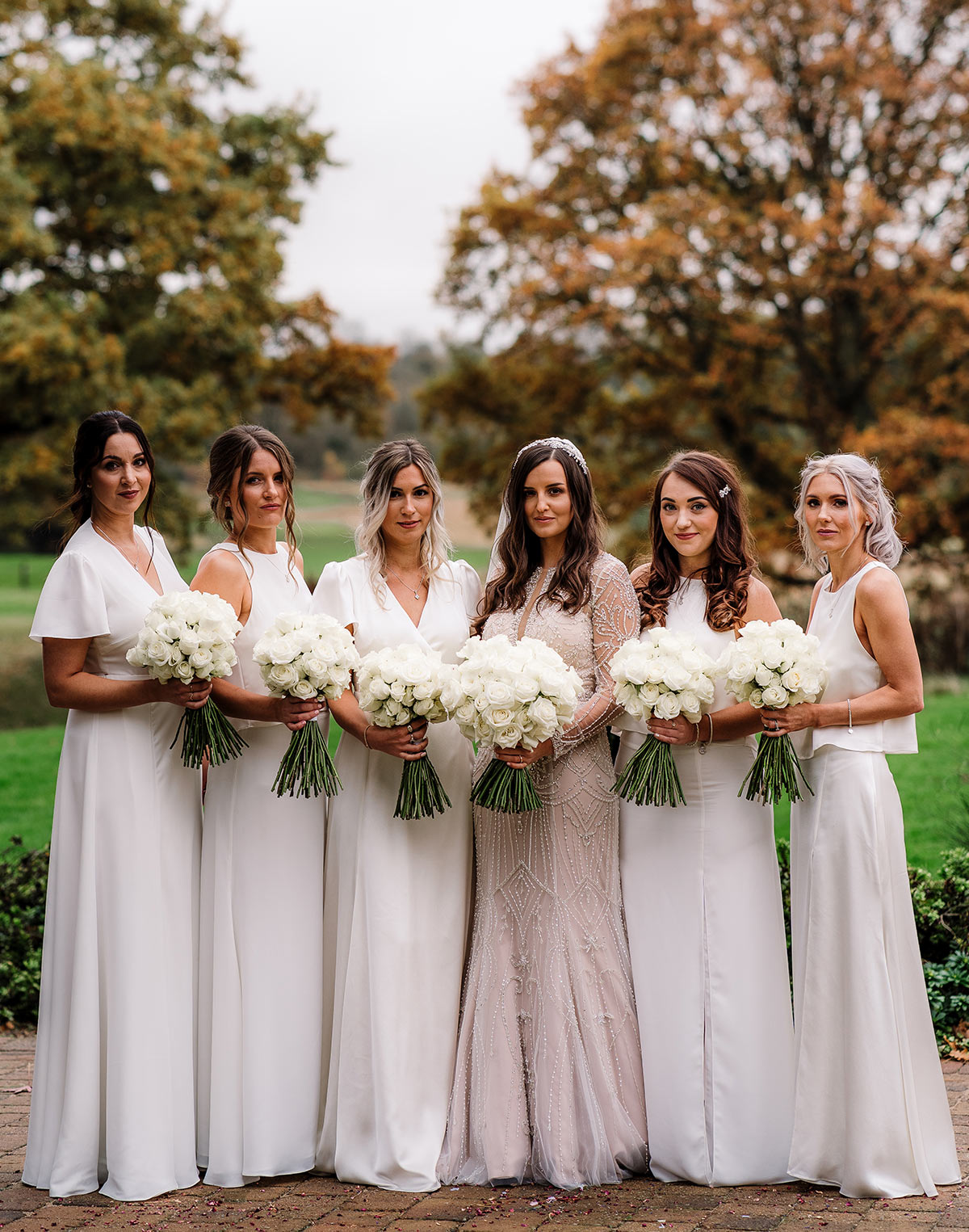 Ivory bridesmaid dresses with nude wedding dress