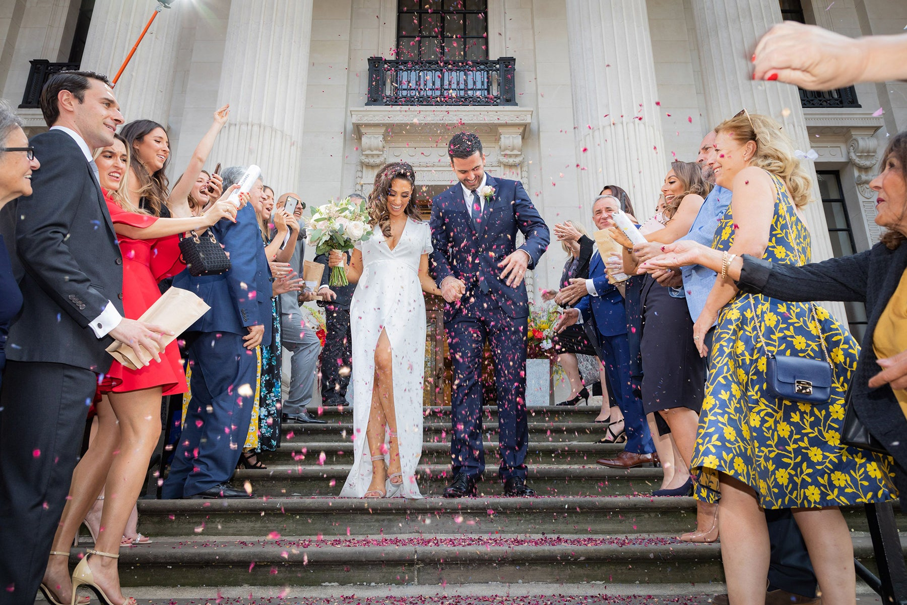Bride Jessica in our Esmee Wedding Dress with her husband at their registry office wedding at Old Marylebone Town Hall