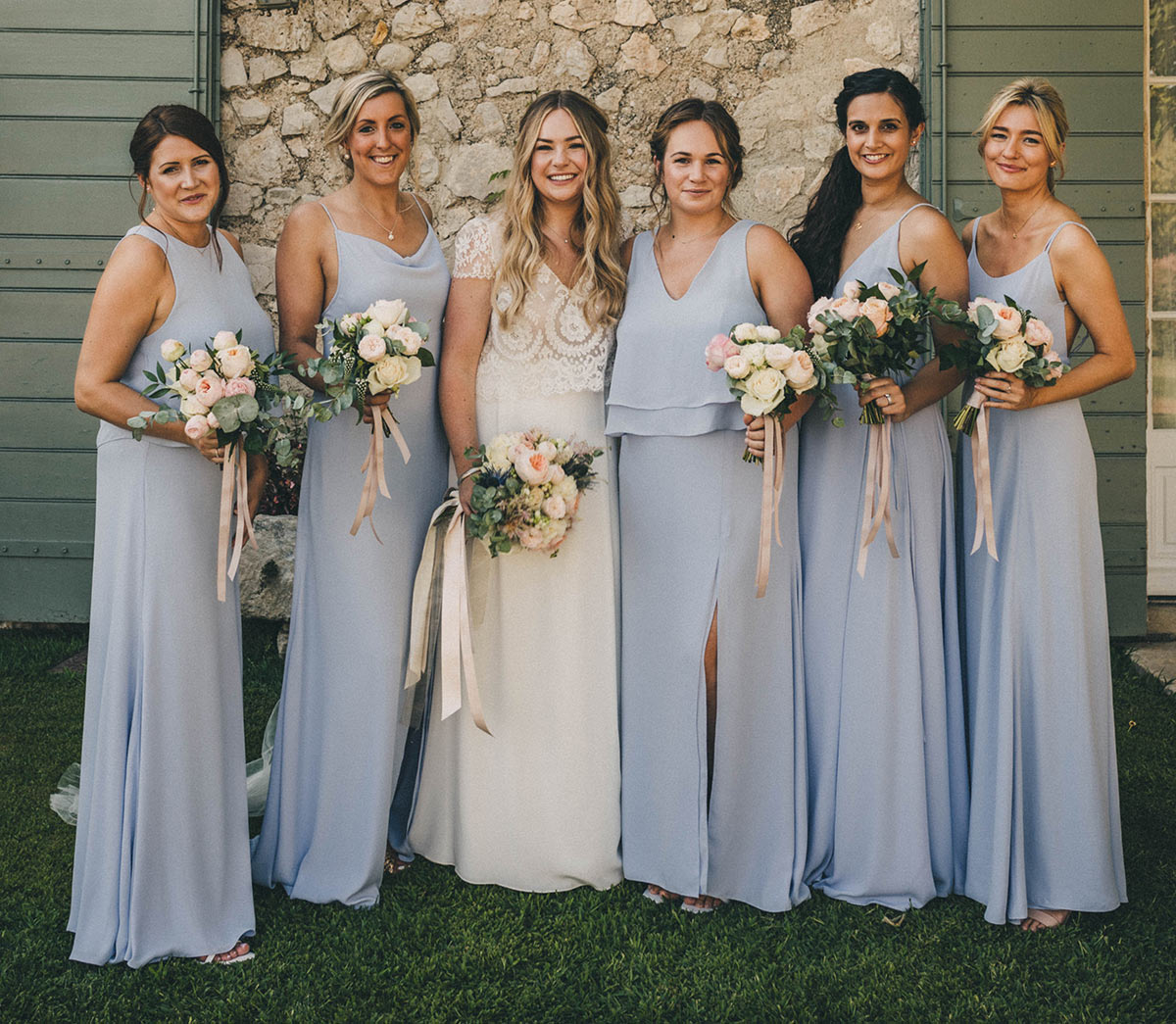 Maddie Chester with her bridemaids. Maddie's bridesmaid were designed and made by us in London to suit her wedding theme colour of light blue.