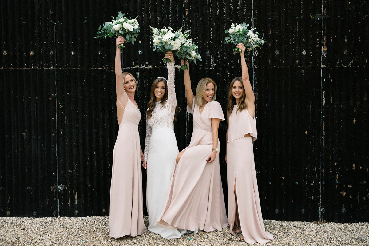Nude coloured mismatched bridesmaid dresses