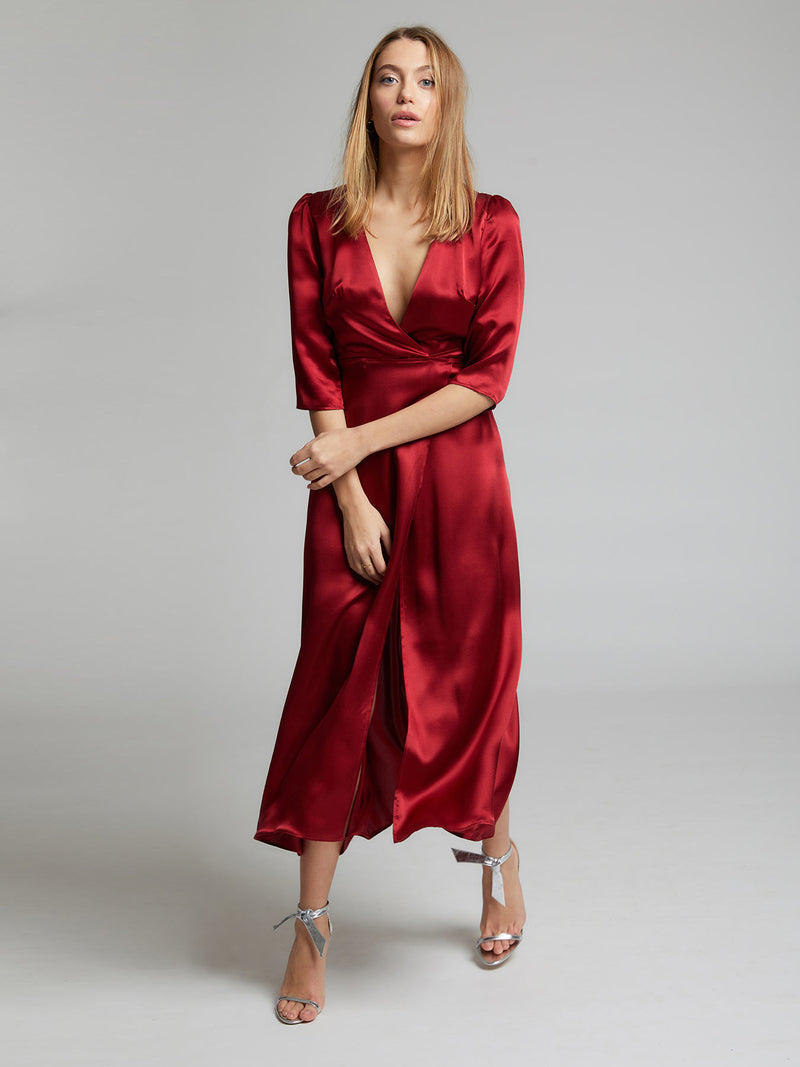 The Diana evening and occasion dress in deep red worn by Heloise Agostinelli. Made from 100% silk