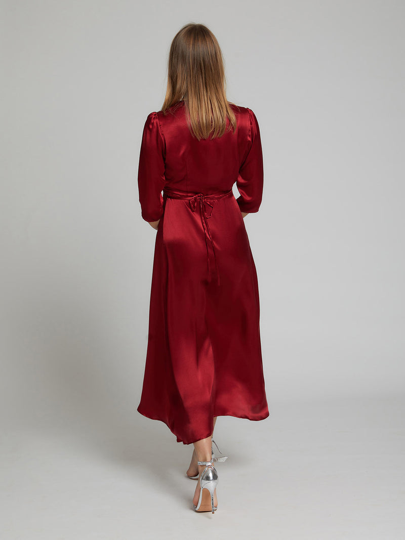 The Diana evening and occasion dress in deep red made from 100% silk. Back view.