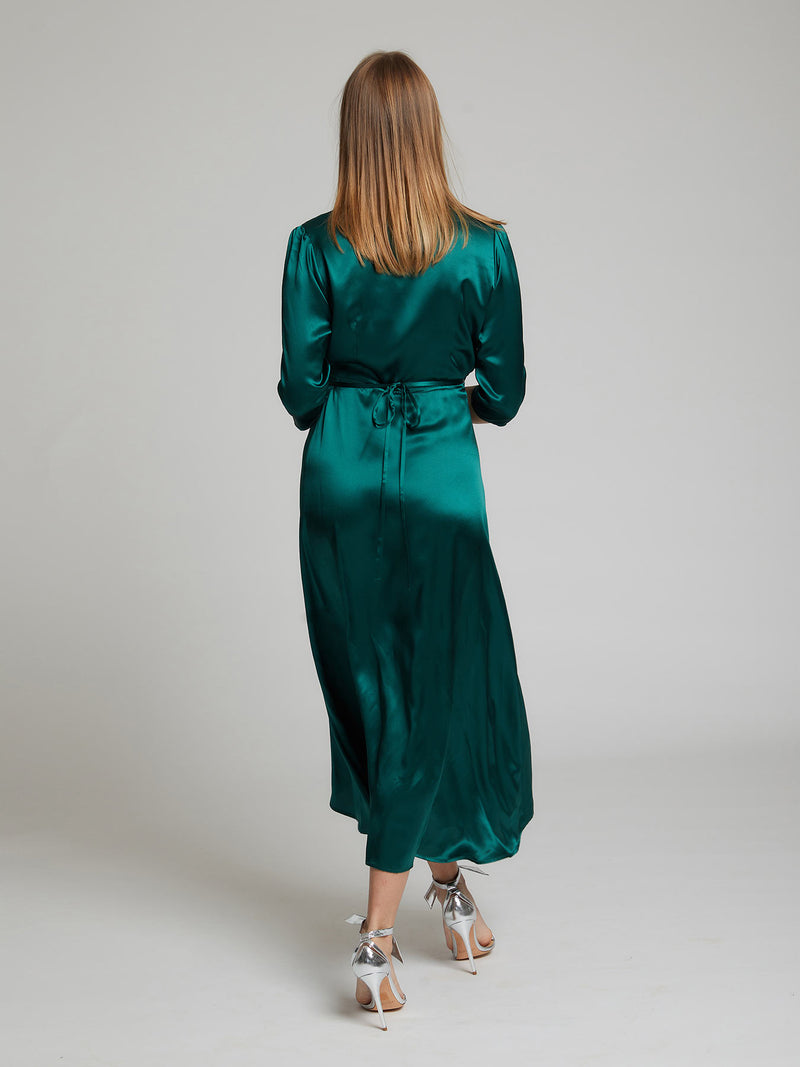 The back view of the Diana midi silk dress in winter green worn by Heloise Agostinelli