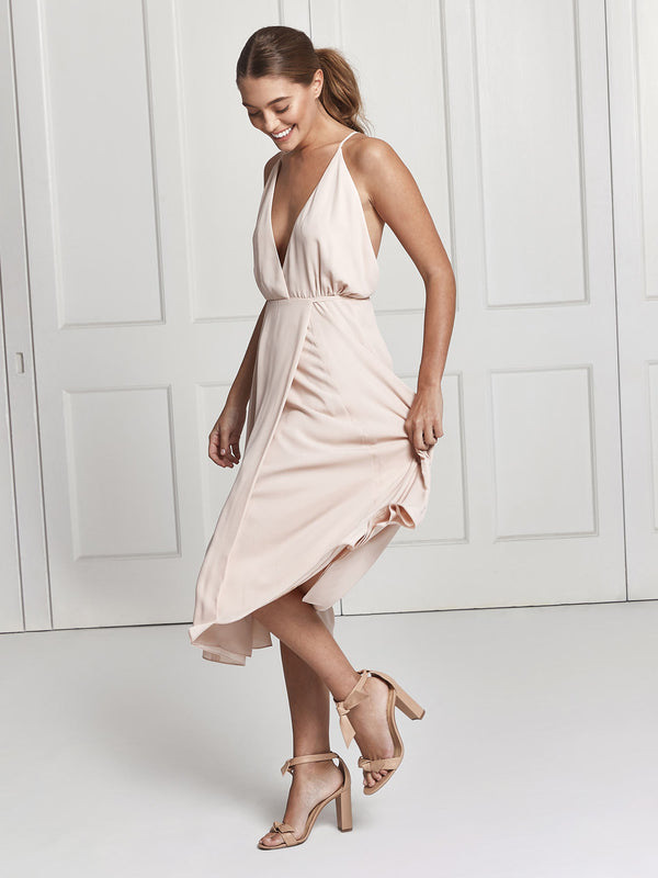 The Eloise midi wrap dress in nude colour worn by Heloise Agostinelli
