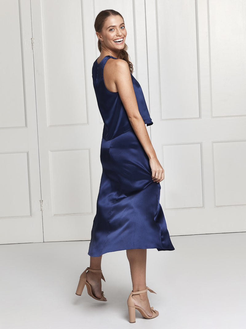 The Eve midi silk skirt and top set in blue worn by Heloise Agostinelli