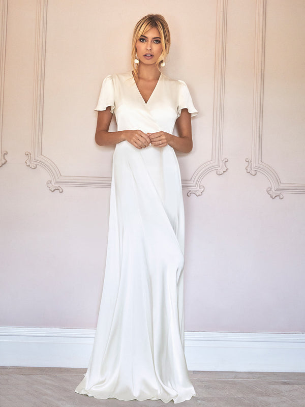 THe Harriet Wedding Dress is a beautiful bride gown made from our luxe heavy-weight ivory silk in our London studio.