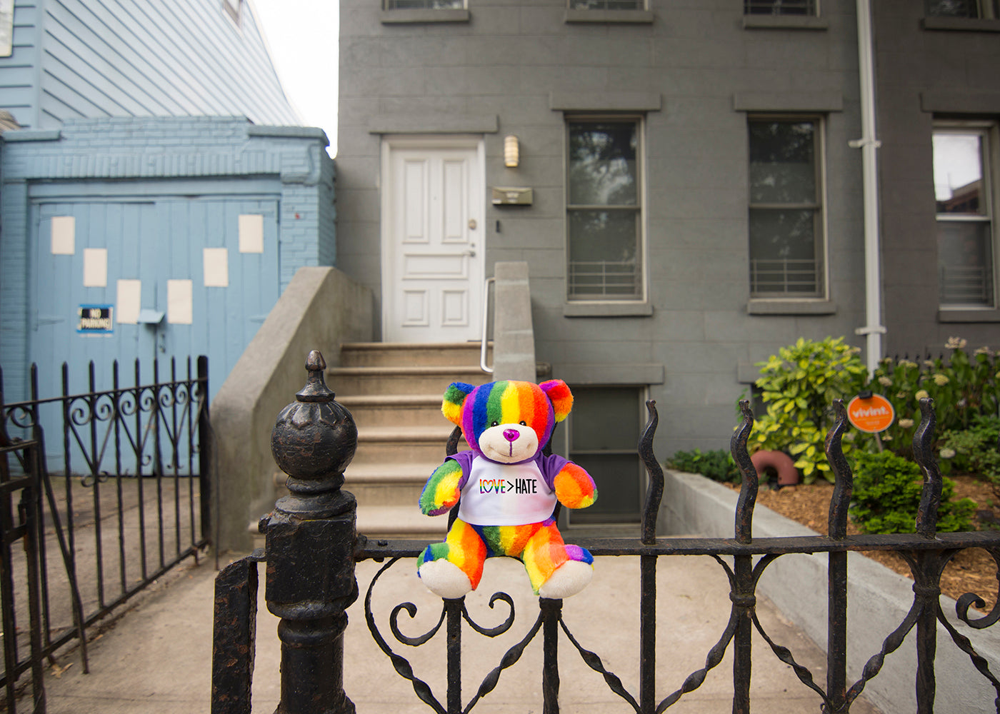 Bear Buggy®'s Totally Pride Teddy bear photographed in front of Brooklyn's Transy House for Pride, the home of trans activisit Sylvia Rivera