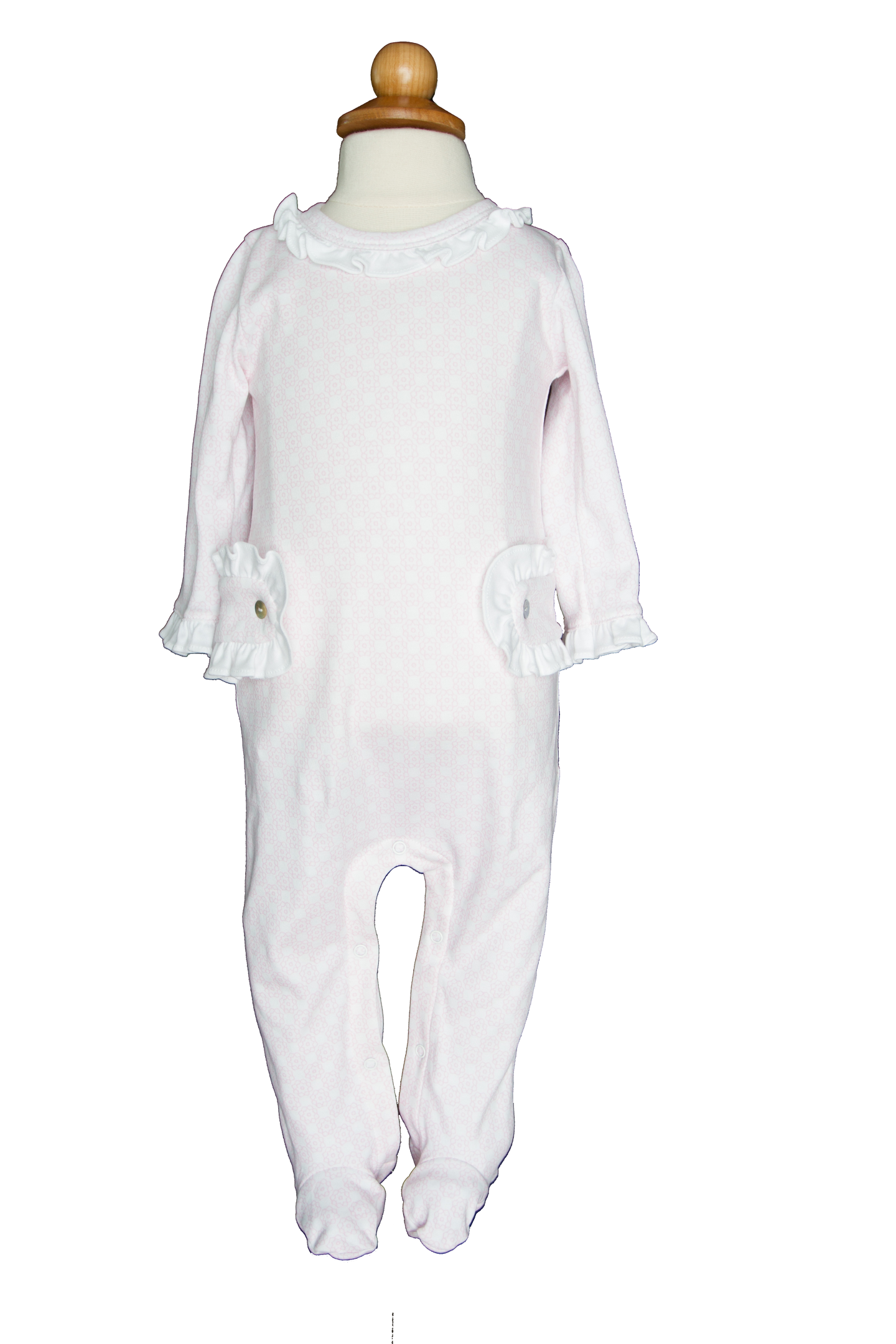 <span>Long sleeved pima cotton footed onesie with ruffles around neck, collar and side plackets. Snaps in stride and back of neck.</span>
