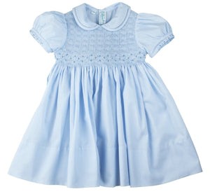 <span>A smocked dress unlike any other! This beautiful little girls dress is a Feltman Brothers classic, with its smocked bodice, delicate hand embroidery, and dainty fagoting trim, with a sweet peter pan collar and intricate hand made diamond embroidery on the smocking, as well as on the sleeves. Ties in the back with a big classy bow for an elegant finish. In this delightful little dress, your loved one is sure to steal the show every time.</span>