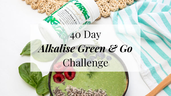 green smoothie bowl topped with berries with text overlay reading 40 Day Alkalise Green & Go Challenge