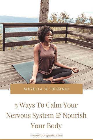 """Pinterest image for this blog post. The photo in the top half is the same photo as above of the woman meditating outdoors. The bottom half is the name of the blog post in gold text that reads """"5 Ways To Calm Your Nervous System and Nourish Your Body"""""""
