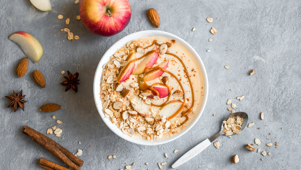 spiced chai smoothie bowl topped with apples and maple syrup