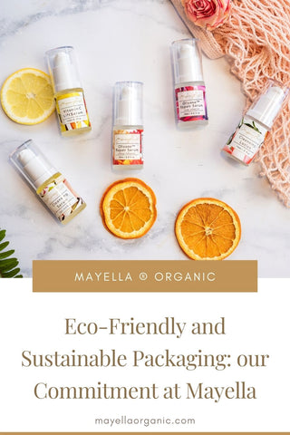 pinterest image of four mayella serums in glass bottles on a marble bench next to decorative slices of orange and lemon