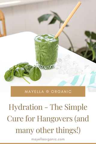 pinterest image of a green smoothie on a white table with a bamboo straw. There is text that reads Hydration - The Simple Cure for Hangovers (and many other things!)