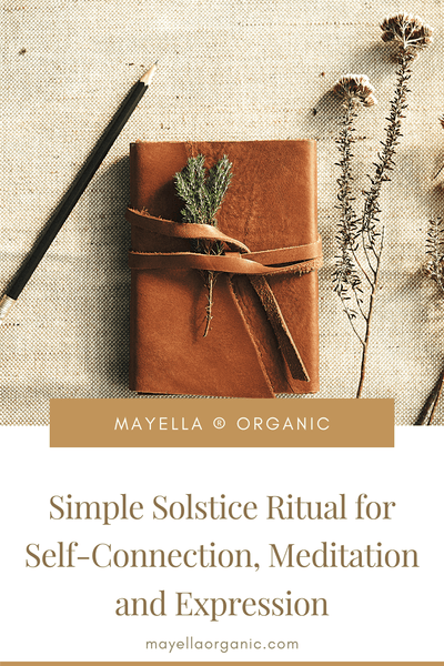 pinterest image with a photo a leather-covered journal next to wild foliage next to text that reads: Simple Solstice Ritual for Self-Connection, Meditation and Expression