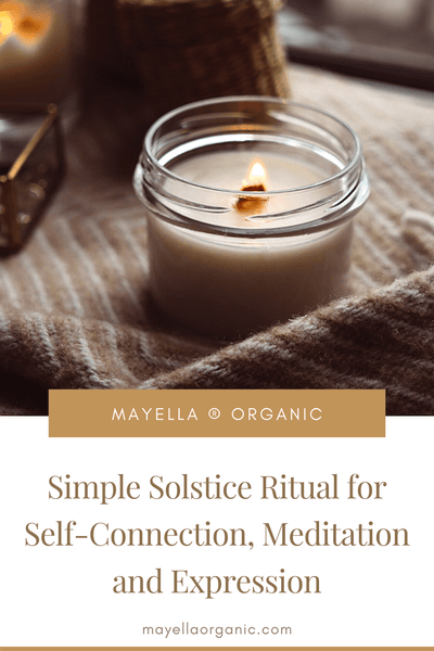 pinterest image with a photo of a small, lit candle in a jar next to text that reads: Simple Solstice Ritual for Self-Connection, Meditation and Expression
