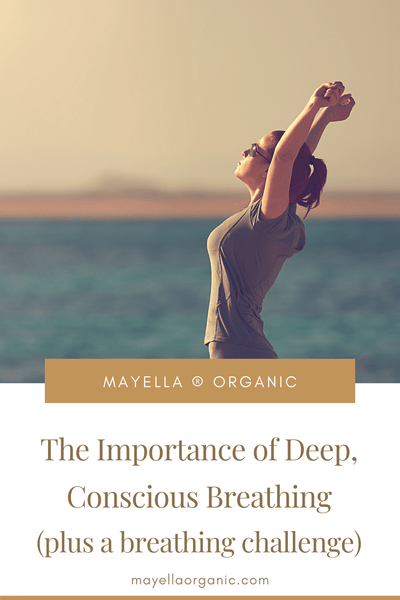 Pinterest Image with a photo at the top and text on the bottom. The photo is of a woman deep breathing at the beach with her arms extended above her head and her back slightly arched. The text reads The Importance of Deep, Conscious Breathing (Plus a Breathing Challenge!)